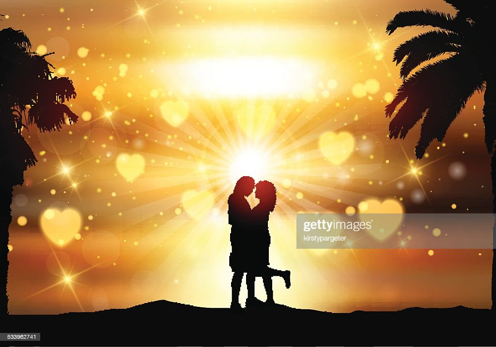Romantic couple against a sunset sky