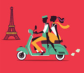 Romantic couple silhouettes on a Vespa scooter with Eiffel Tower in the background
