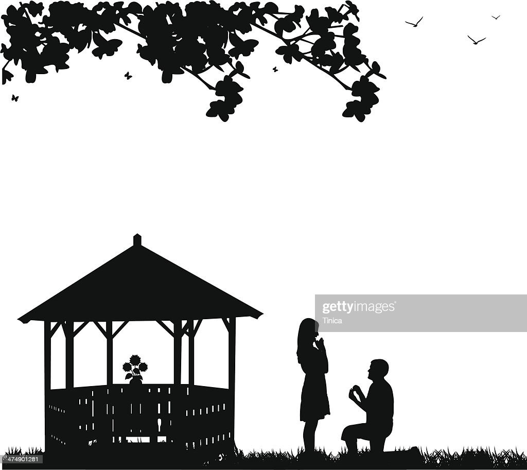 Romantic proposal in park or garden under the branches