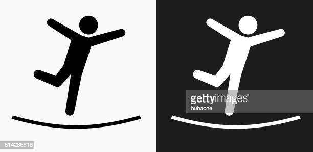 rope balance icon on black and white vector backgrounds - sport set competition round stock illustrations