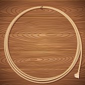 Rope lasso on wood background