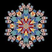 Rosette patterns in nostalgic retro colors. Symmetric vintage rosette on black background
