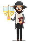 Rosh Hashanah. Jew man in traditional clothes holding bible and menorah.