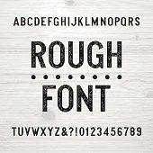 Rough alphabet font. Scratched type letters.