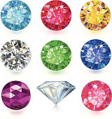 9 round cut faceted gemstones in a rainbow colors