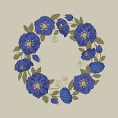 Round floral frame with elegant blue flowers of black onyx helleborus and a place for your text.