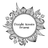 Round frame of black and white doodle leaves