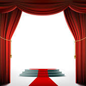 Round podium under the red curtain.
