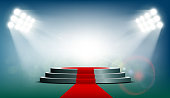 Round podium with a red carpet