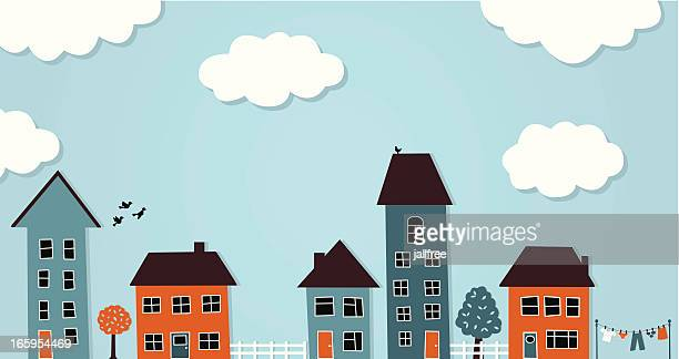 Row of different houses with clouds in sky