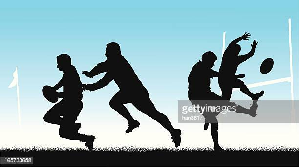 Rugby players silhouetted in action