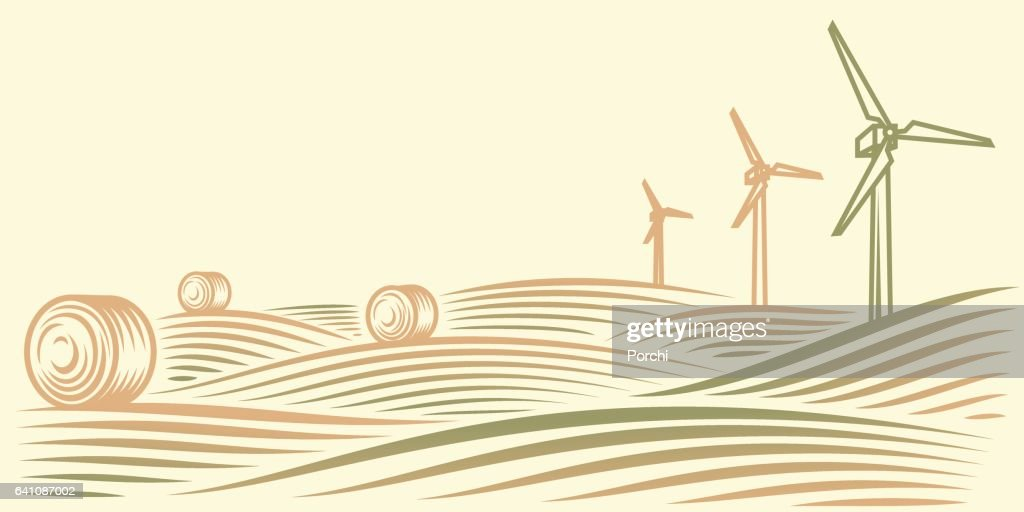 Rural landscape with fields, haystacks and wind turbines