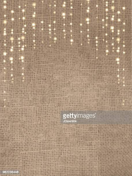 rustic burlap background with string lights - string stock illustrations