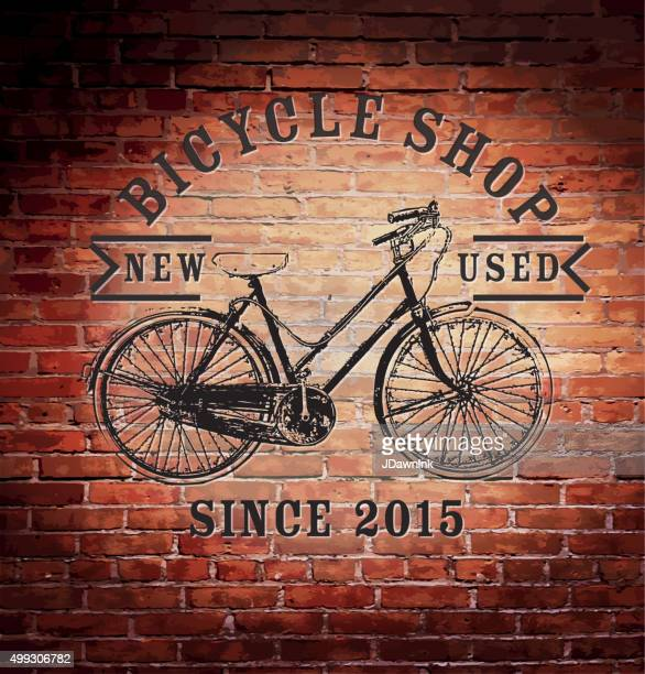 Rustic old fashioned brick wall with vintage bike shop sign