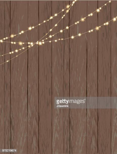 rustic wooden background with string lights - rustic stock illustrations