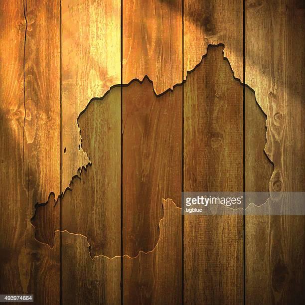 Rwanda Map on lit Wooden Background