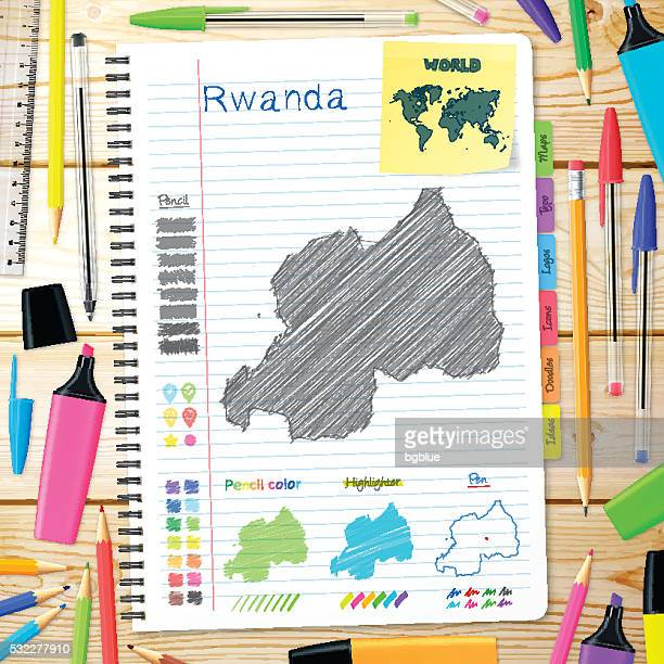 Rwanda maps hand drawn on notebook. Wooden Background