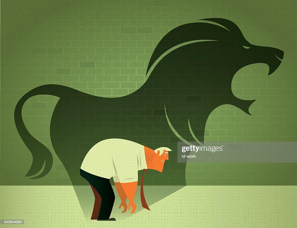 sad businessman with angry lion shadow : stock illustration