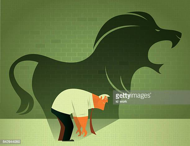 sad businessman with angry lion shadow