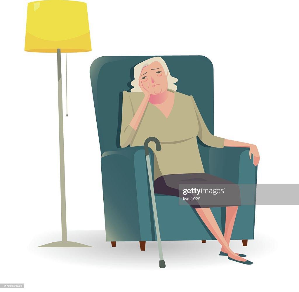 Sad senior woman with cane sitting on a sofa.