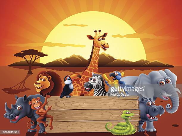 Safari animals and a sunset behind a wood sign