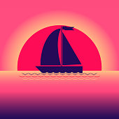 Sailboat, boat on the background of the sunset in the sea (ocean).