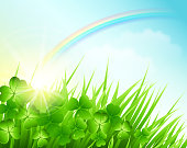 Saint Patrick's Day background with clovers and a rainbow