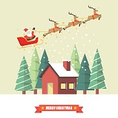 Santa Claus and his reindeer sleigh with winter house