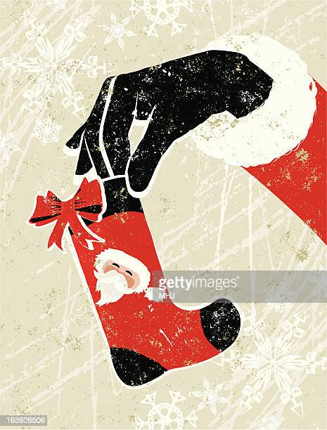 santa claus hand holding a small christmas stocking - silk screen stock illustrations