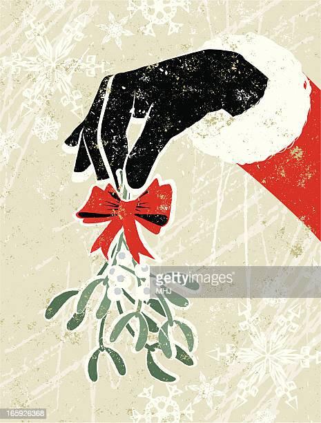 santa claus hand holding a sprig of mistletoe - mistletoe stock illustrations, clip art, cartoons, & icons