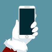 Santa Claus hand holding cellphone