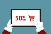 Santa Claus holding tablet with discount promotion