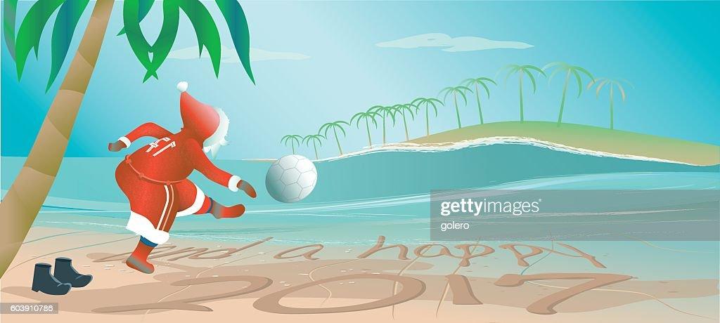santa claus kicking football at beach for new year 2017