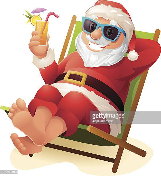 Santa Claus relaxing at Beach with Sunglasses and drink