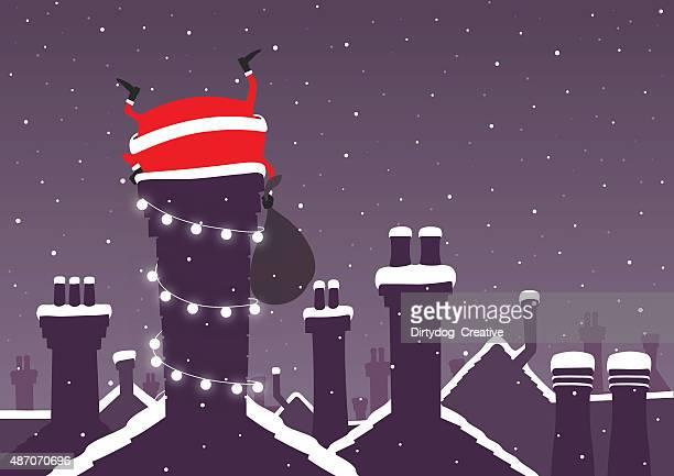 Santa stuck einen Kamin an Weihnachten mit Schnee