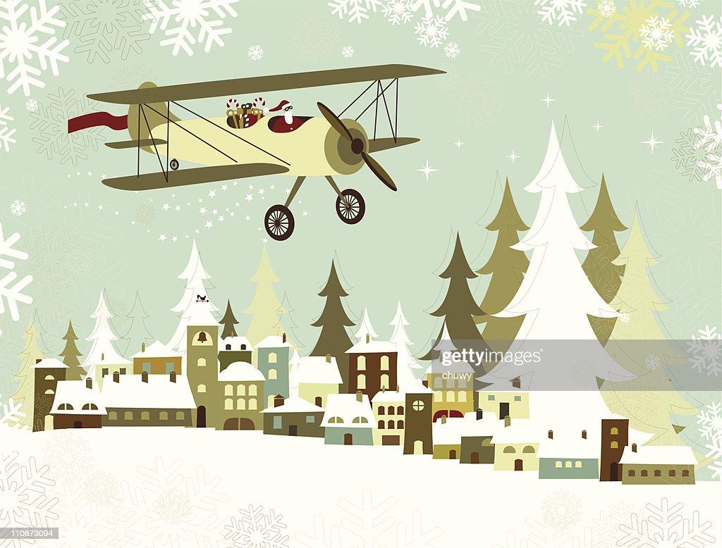 Santa's Avión volando sobre un Christmas village : arte vectorial