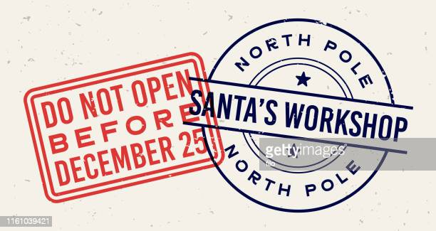 santa's workshop christmas holiday letter stamps - postage stamp stock illustrations