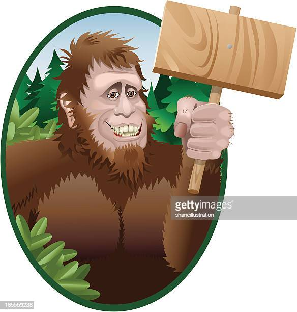 sasquatch with sign - bigfoot stock illustrations