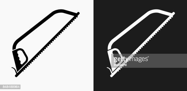 saw icon on black and white vector backgrounds - serrated stock illustrations, clip art, cartoons, & icons