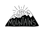 Say Yes to the Mountains. Mountain silhouette with sun, contains hand drawn text.