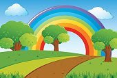 Scene with green lawn and rainbow in sky