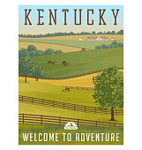 Scenic Kentucky landscape with rolling hills, horses and fences and stables.