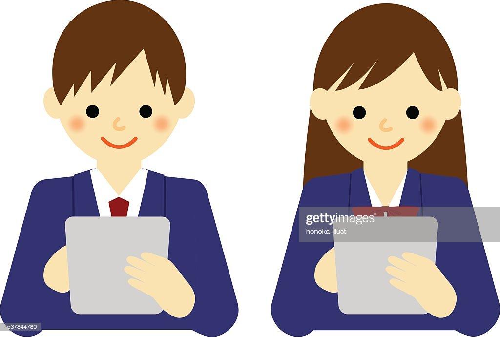 school boy and school girl using tablet