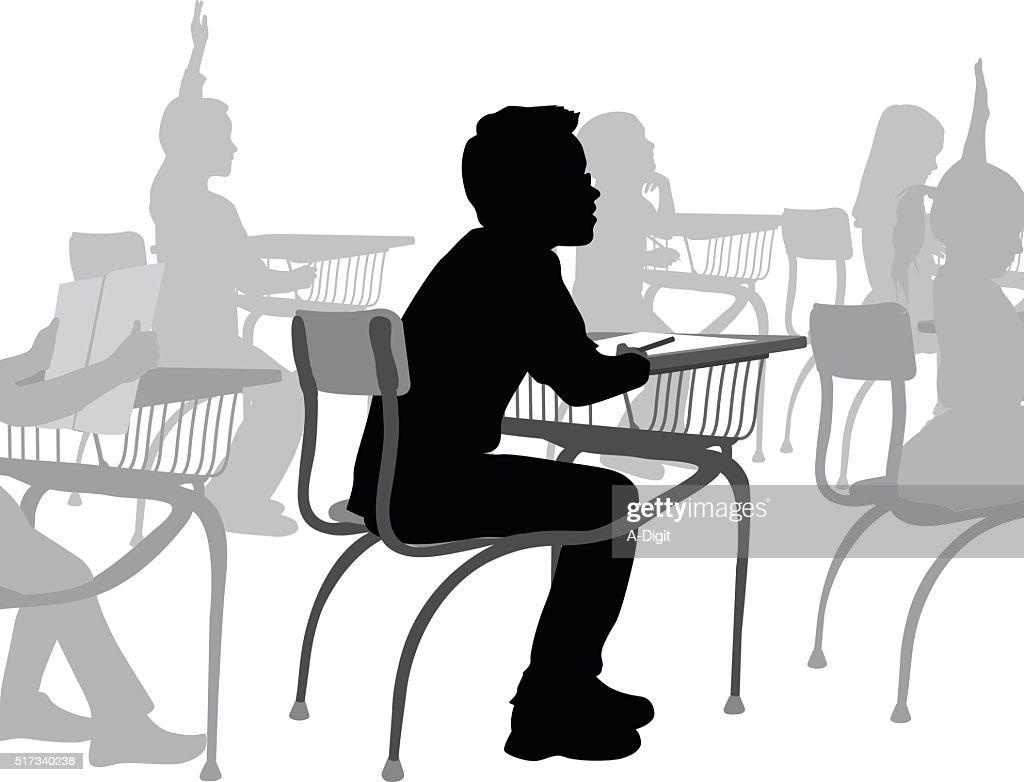 School Boy At His Desk