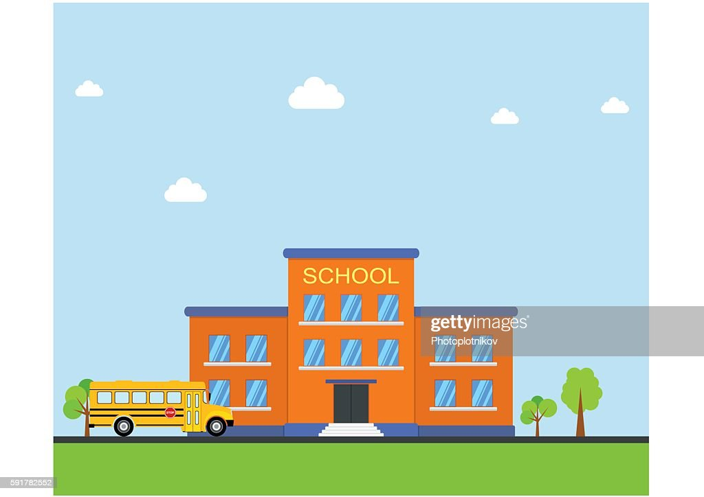 School building and bus. Front yard with trees.