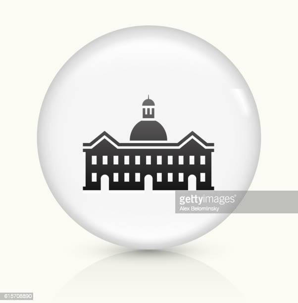 school building icon on white round vector button - town hall stock illustrations