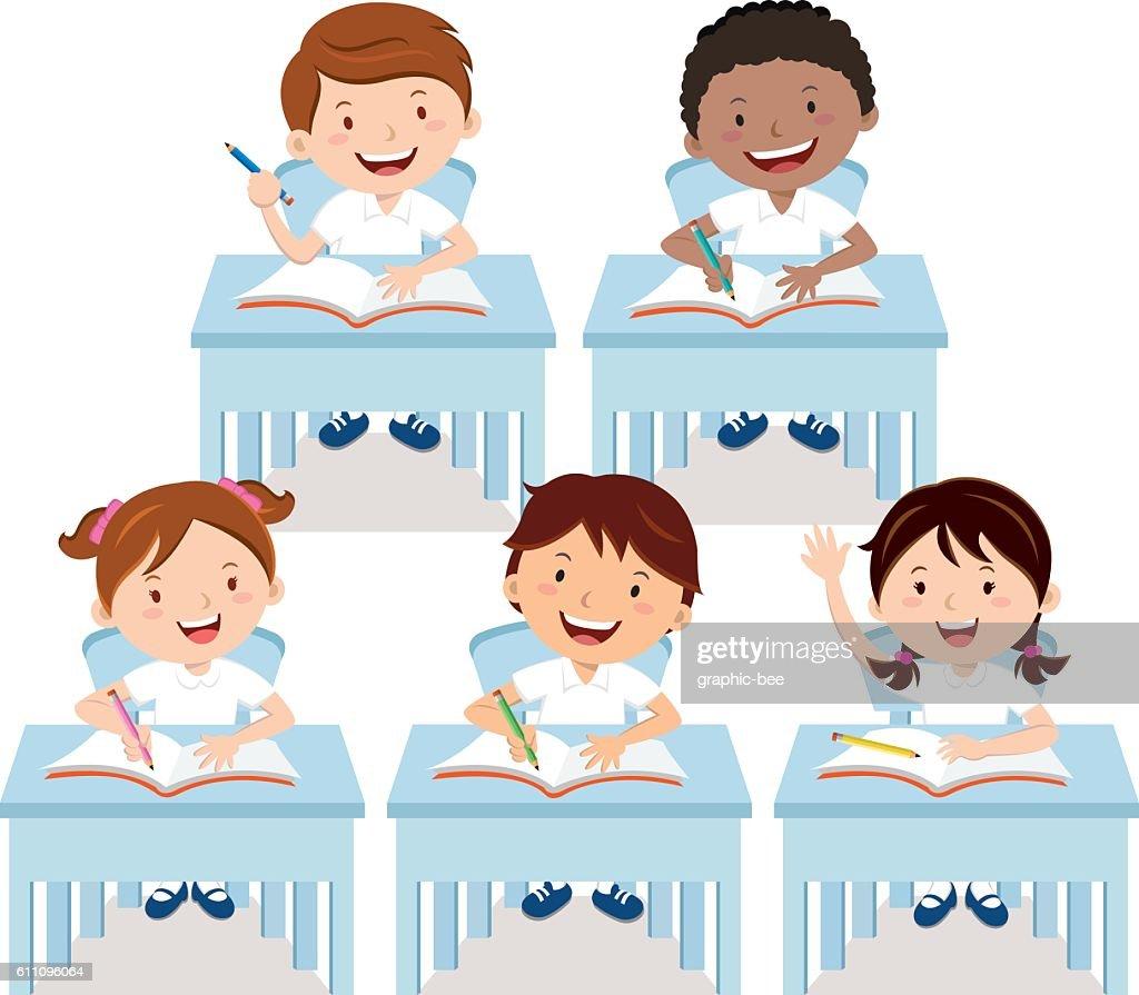 School children studying in classroom