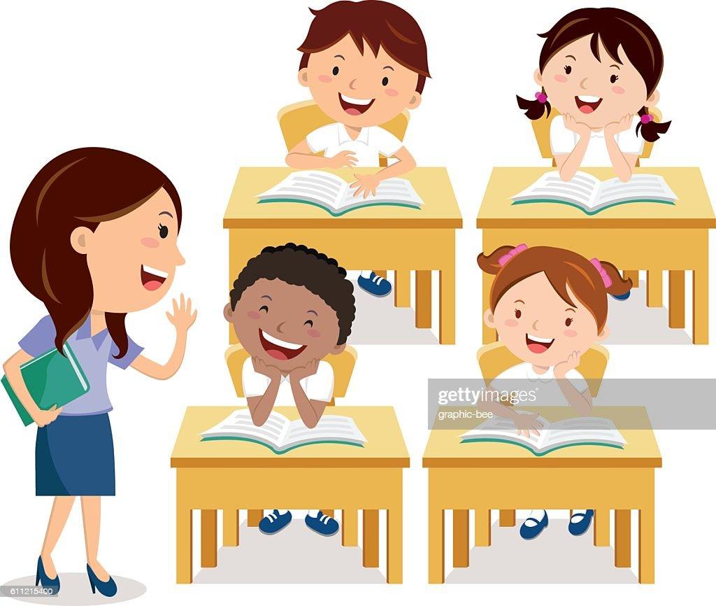 School kids studying with teacher