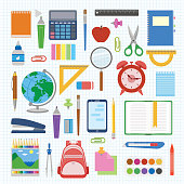 School supplies and items set on a sheet in a cell. Back to school equipment. Education workspace accessories on white background