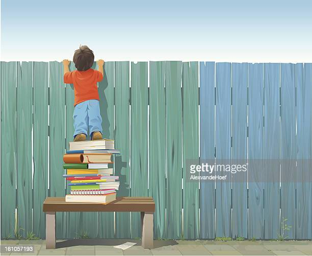 schoolboy on pile of books looking over fence - curiosity stock illustrations